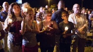 A candle-light vigil was held for the victims. Photo courtesy AFP.