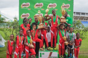 Photo 4 - Boys & Girls Championship winners Diamond Vale Government Primary celebrate with their medals & trophies atop the competition podium last year