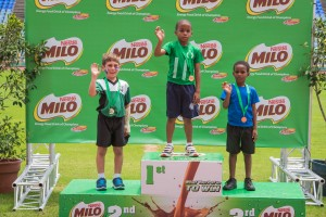 Photo 8 - Waving with pride – youngsters collect their medals atop the podium